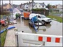 A flooded road in Carmarthen is pumped out