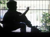 Sitting child in silhouette