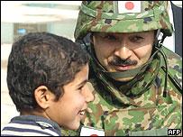 Japanese Self-Defence Force Commander Lieutenant Colonel Masahisa Sato (right)