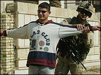 US soldiers search an Iraqi