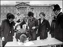The Sex Pistols outside Buckingham Palace