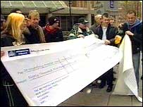 The protesters with a giant cheque
