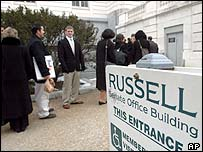 Workers return to the Russell Senate Office Building after a toxin alert