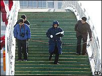 Police take measurements on the bridge, at Miyun
