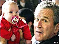 President Bush holding a baby