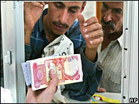 Men picking up money