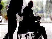 Carer and wheelchair user (generic)