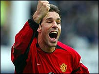 Manchester United striker Ruud van Nistelrooy celebrates his 100th goal for the club