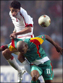 Tunisia's Karim Hagui climbs above El Hadji Diouf of Senegal