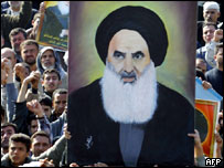Iraqi Shia demonstrators carrying portrait of spiritual leader Ayatollah Ali al-Sistani