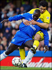 Chelsea's Jimmy Floyd Hasselbaink and Charlton's Mark Fish