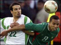 Algeria's Hocine Achiou battles with Kharja Oussime of Morocco