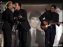 Sting (left), Dave Matthews (centre) and Vince Gill performed a Beatles tribute
