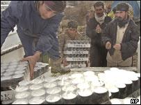 Kurdish smugglers prepare to take alcohol into Iran