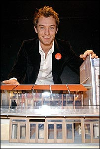 Jude Law with a model of the renovated Young Vic
