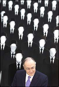 Michael Howard amid cardboard cut-out civil servants