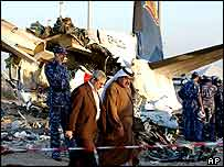 Officials at the site of the Kish Air crash, 10 February 2004