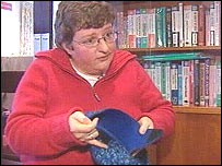 Katie Mather, of Neath Port Council, demonstrates the safe slipper