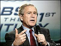 President George W Bush addresses an audience at the SRC Automotive in Springfield, Missouri