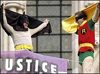 Protesters dressed as superheroes