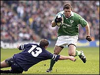 Ireland's Brian O'Driscoll weaves around Scotland's Andy Craig