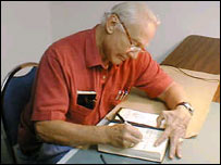 Aldrin signs a book