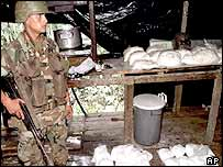 Colombian soldier guards cocaine haul