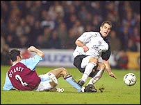 Fulham's Carlos Bocanegra was sent off for this tackle on Mark Delaney