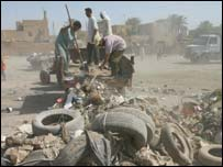 Iraqis work to clear rubble in Baghdad