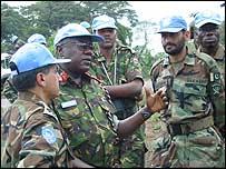 General Daniel Opande (centre)