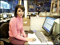 Mona Atari working in the newsroom of Al-Hurra