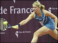 Kim Clijsters reaches for a shot