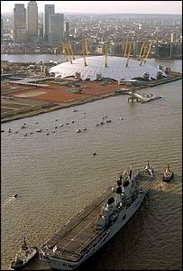 Ark Royal sails up the Thames