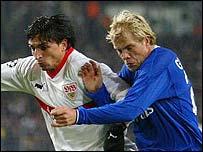 Chelsea's Eidur Gudjohnson challenges Stuttgart's Fernando Meira