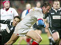Ulster's Neil Best charges towards the Ospreys' line
