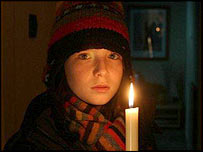 Child holding a candle