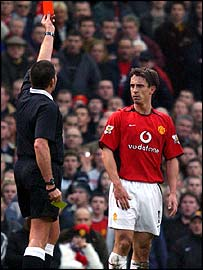 Referee Jeff Winter sends of Manchester United defender Gary Neville