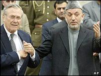 Donald Rumsfeld (L) with Hamid Karzai