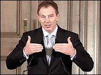 Tony Blair giving his monthly press conference