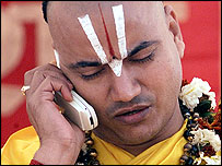 An Indian holy man on a mobile phone