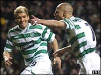 Stilian Petrov rushes to congratulate scorer Henrik Larsson