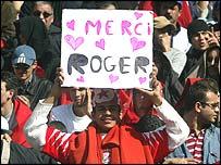 A Tunisia supporter shows his gratitude towards the French coach