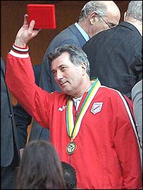 Roger Lemerre picks up his winner's medal