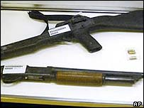 The shotguns used by the Columbine High School killers are shown on display at the Jefferson County Fairgrounds in Lakewood