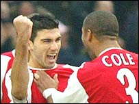 Jose Antonio Reyes and Ashley Cole celebrates one of the Spaniard's goals against Chelsea