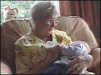Doreen Roberts holds a baby