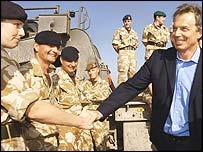 Tony Blair meets British troops in Basra earlier this year