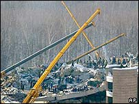 Workers at site of collapsed roof of the Transvaal water park in Moscow