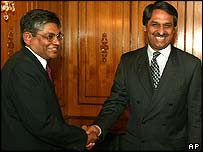 Indian External Affairs joint secretary Arun Kumar Singh (left) is received by his Pakistani counterpart, Jaleel Abbas Jilani