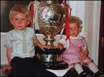Katrina Robinson (right) was just two when she was pictured with the Challenge Cup following Wigan's success in 1990 or 1991 - she is not sure which